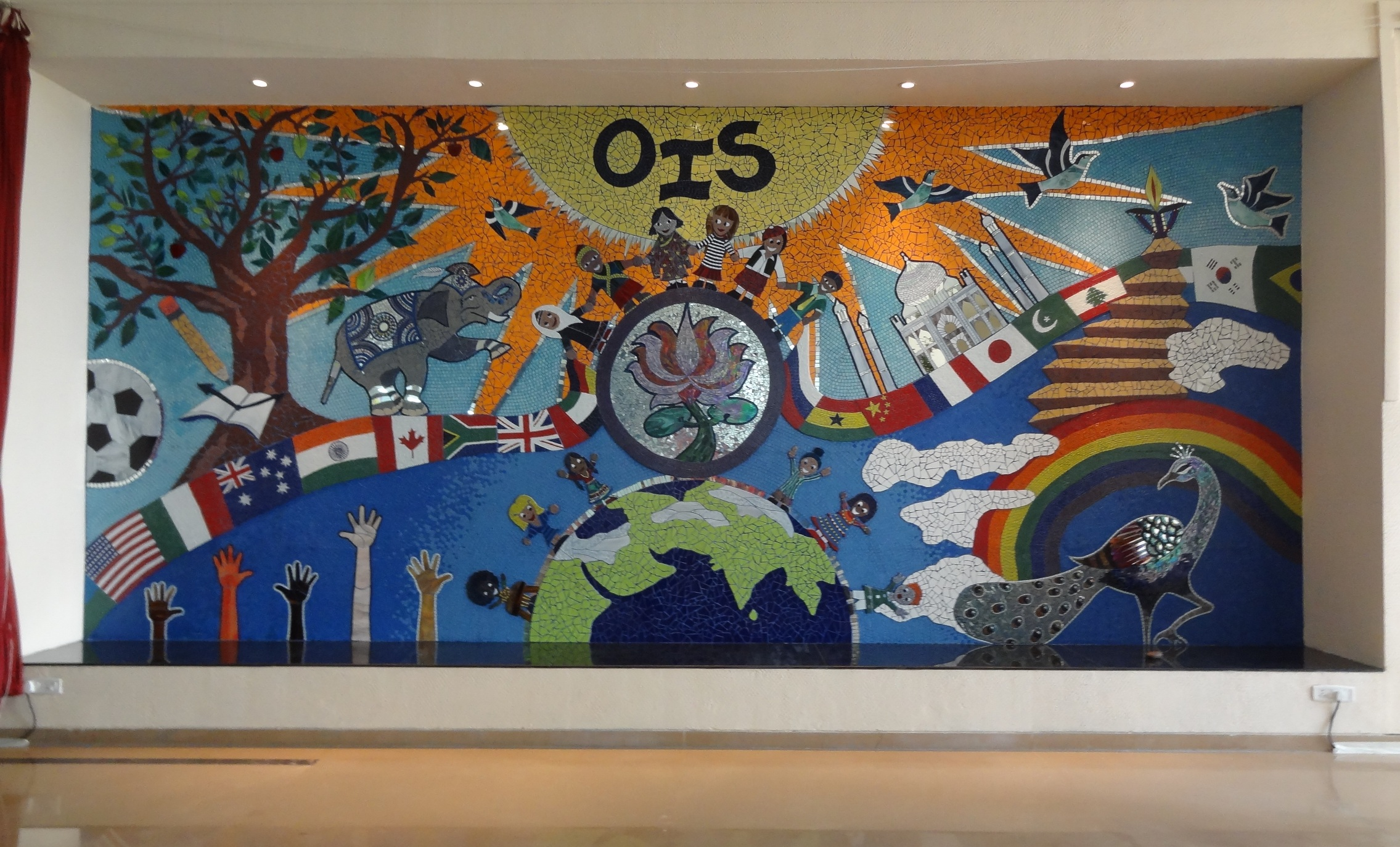 Wall size mural at oberoi international school the for Mural mosaic