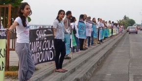 Campa Cola residents form a human chain