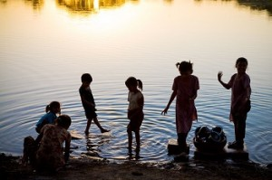 children play in water in the summer