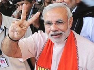 Narendra Modi flashes the victory sign