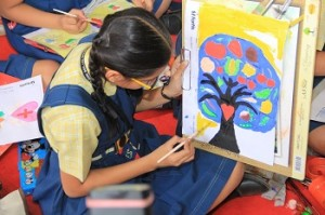 School girl drawing healthy diet at Fortis Hospital Health Mela 2015.